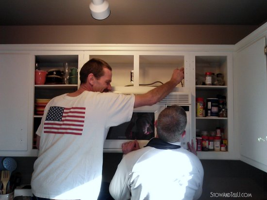 Modified kitchen cabinet for undermount microwave