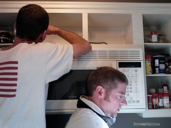 Here is a few shots of Ken and Kevin installing the microwave.