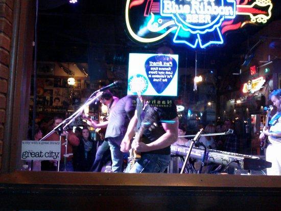 band-plays-through-window-honky-tonks
