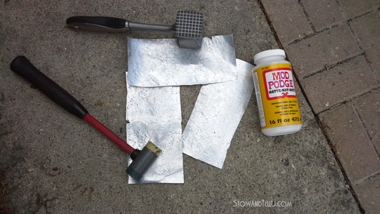to-create-hammered-metal-look-lay-soda-can-piece-down-on-cement-and-hammer