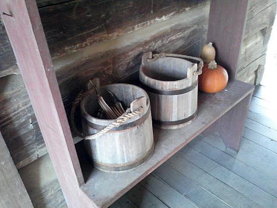 buckets on an 1800 era porch