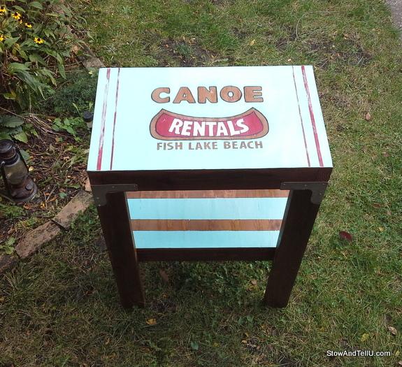 vintage-canoe-rental-sign-table